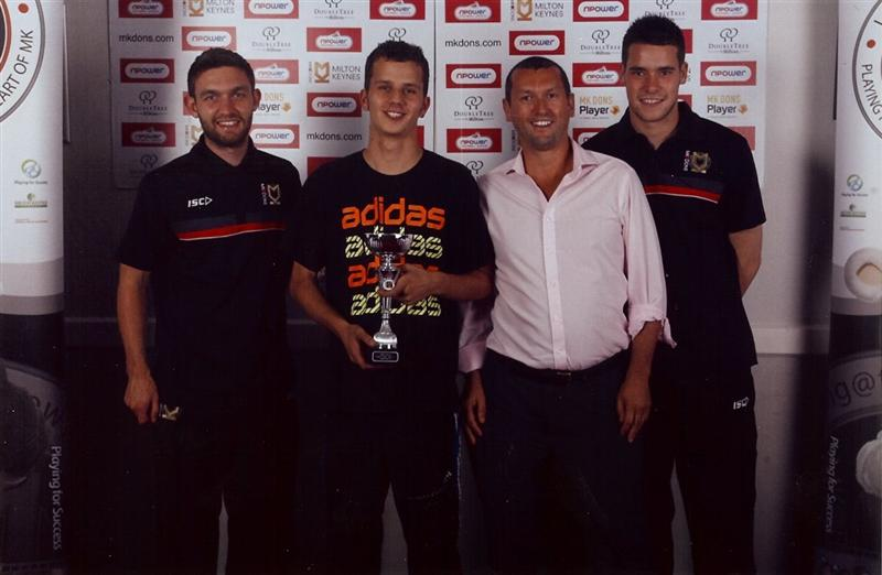 Image of Rob Scott with MK Dons players